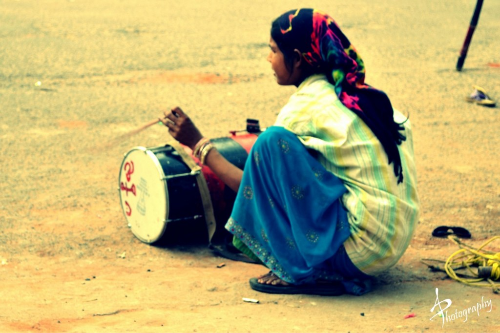 Banjara women playing drums