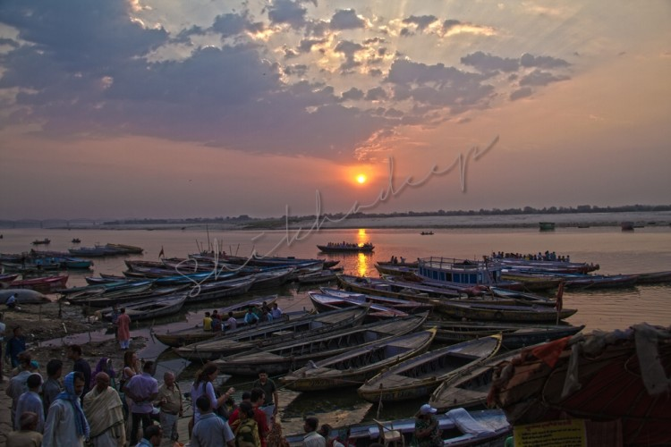 Sunrise over boats in Ganges in Varanasi