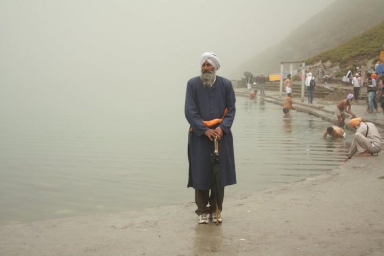 a sikh pilgrim at hemkund sahib lake
