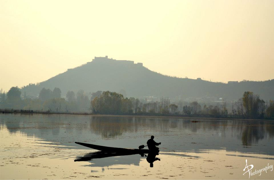 a shikara in sunset dal lake sringar