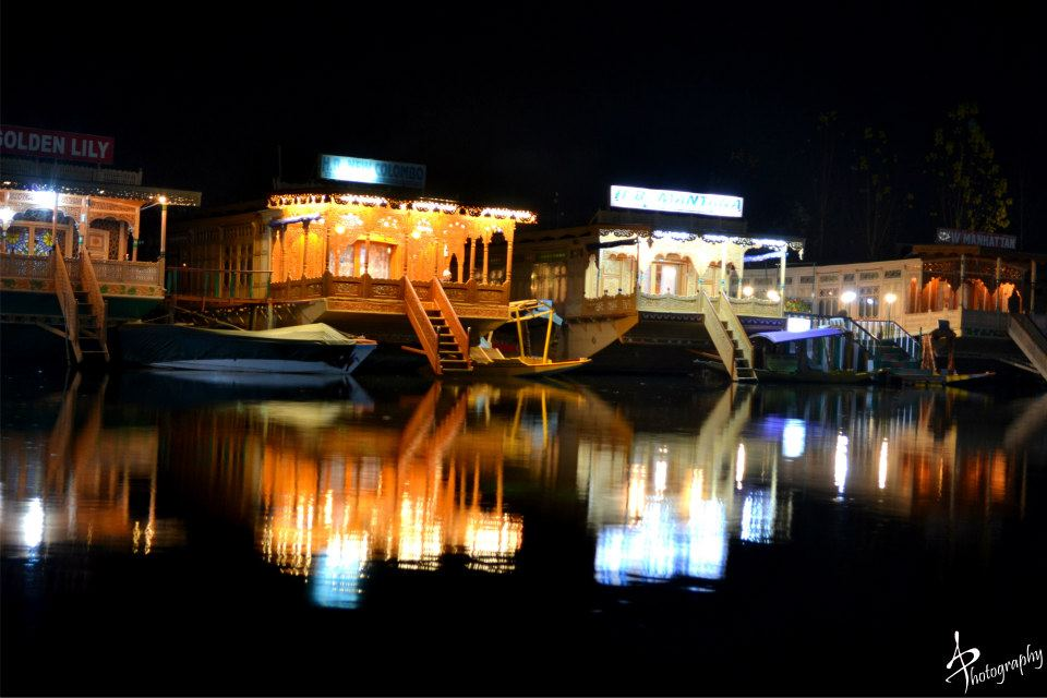 House boats shining in dal lake in night srinagar kashmir