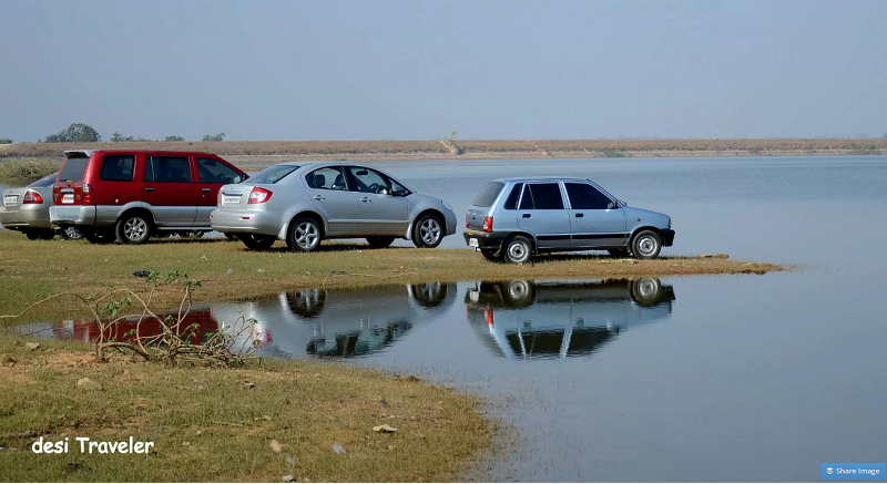 Cars parked next to Nagasamundar Lake  Road Trip