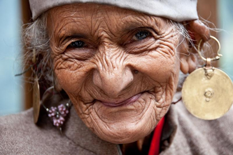 smiling old lady in traditional dress in uttarakhand in Himalayas