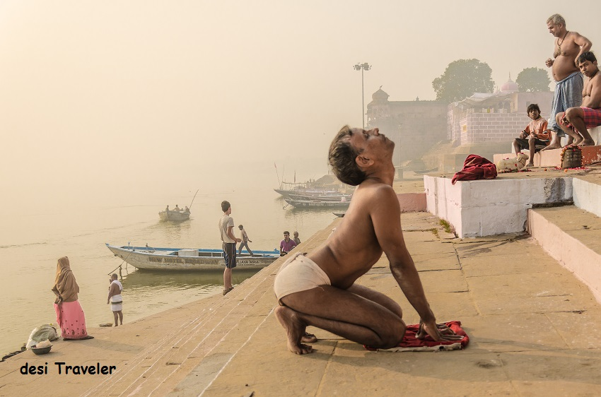 Man wearing Langot doing yoga on Varanasi Ghats