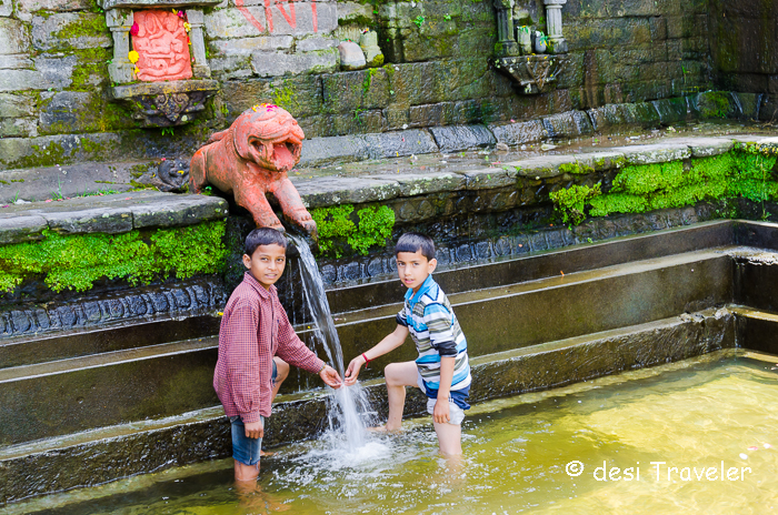 kids play in hot water spring in a temple Naggar