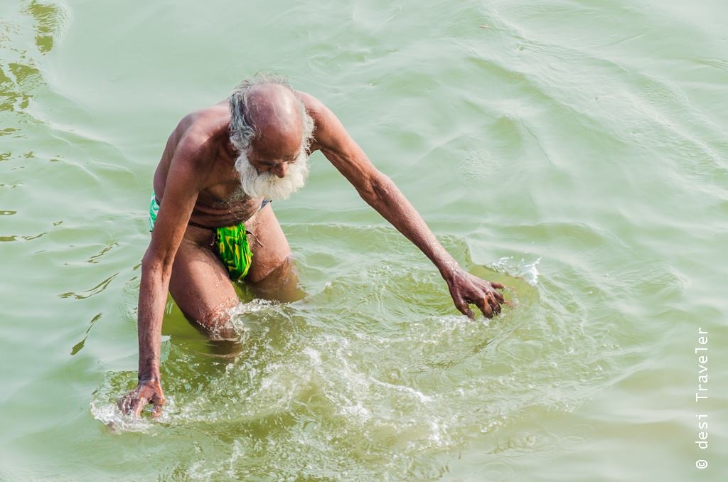 Old man bathing in langot in Ganges Varanasi sunrise boat ride