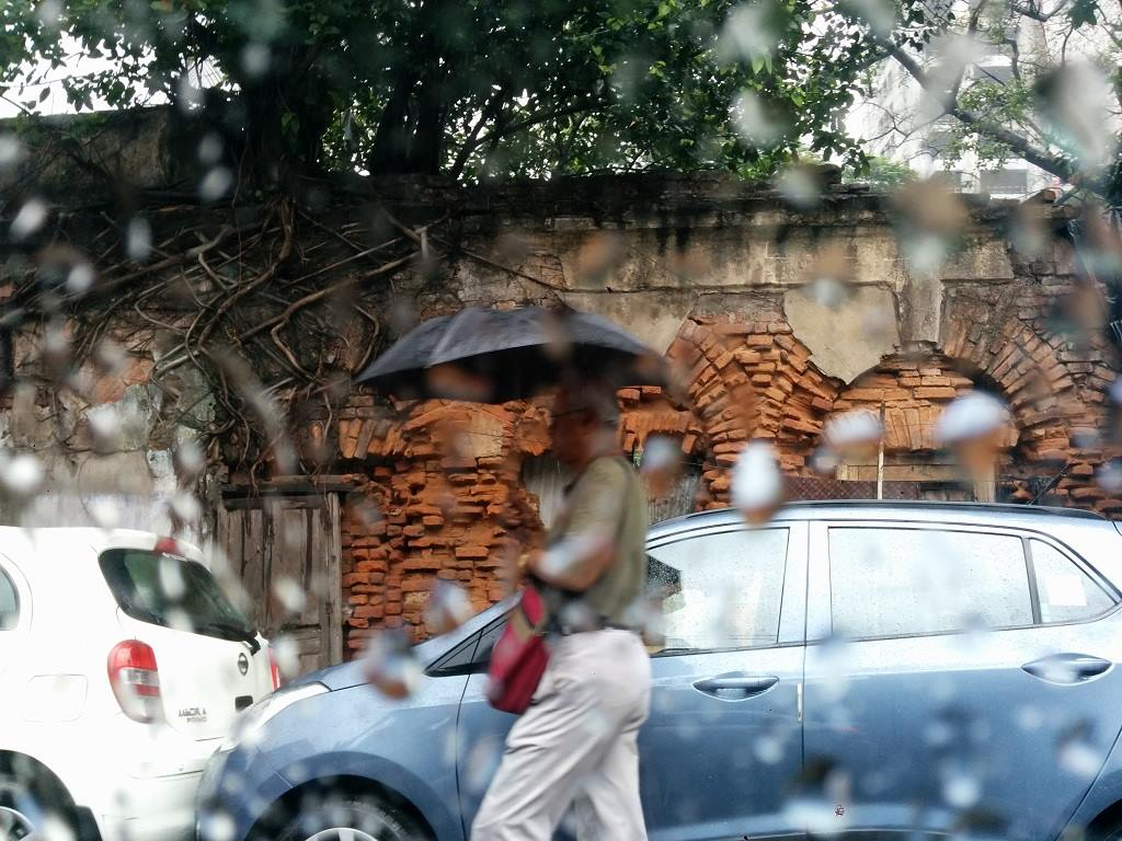 Chasing Monsoon Old Man with Umbrella in Kolkata