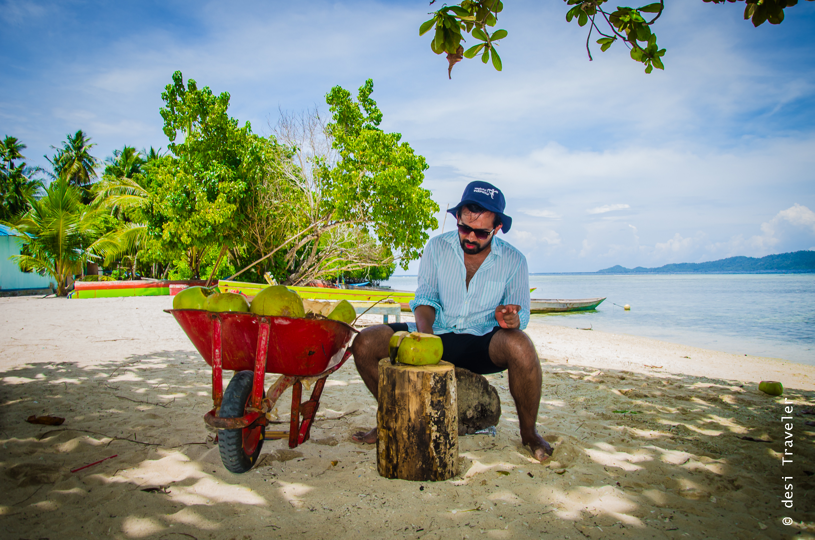 Arborek Toursim Village man chopping coconuts