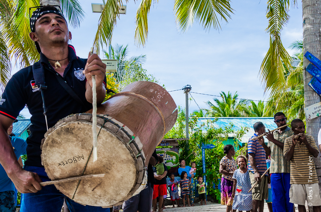 man playing drum Raja Ampat Indonesia
