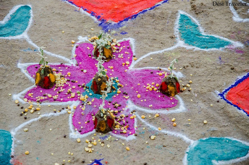 Traditional Village Rangoli design with Cow Dung, flowers lentis