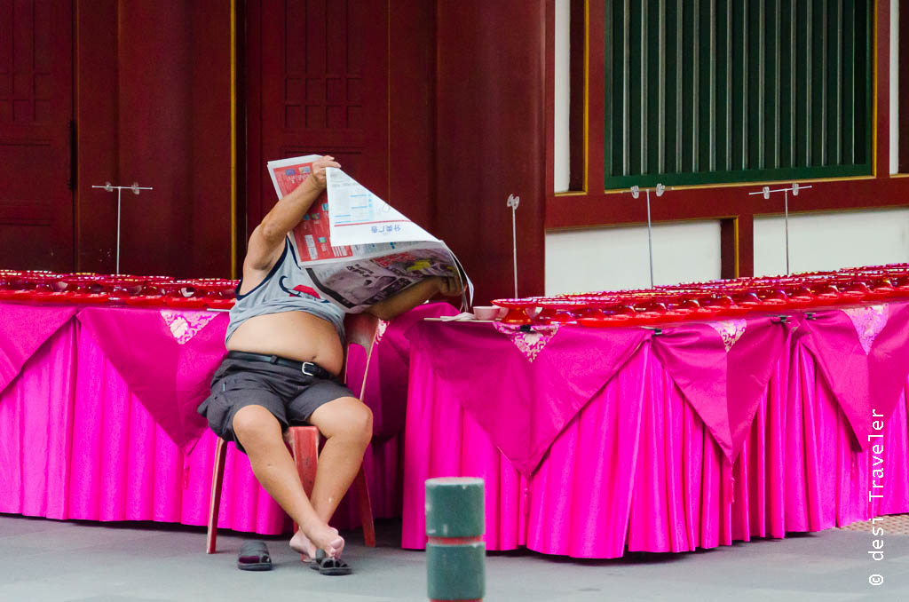A man reading Chinese newspaper in Singapore Chinatown