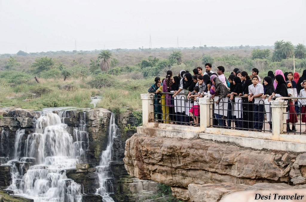 tourists looking at Ethipothala waterfalls from an observation deck