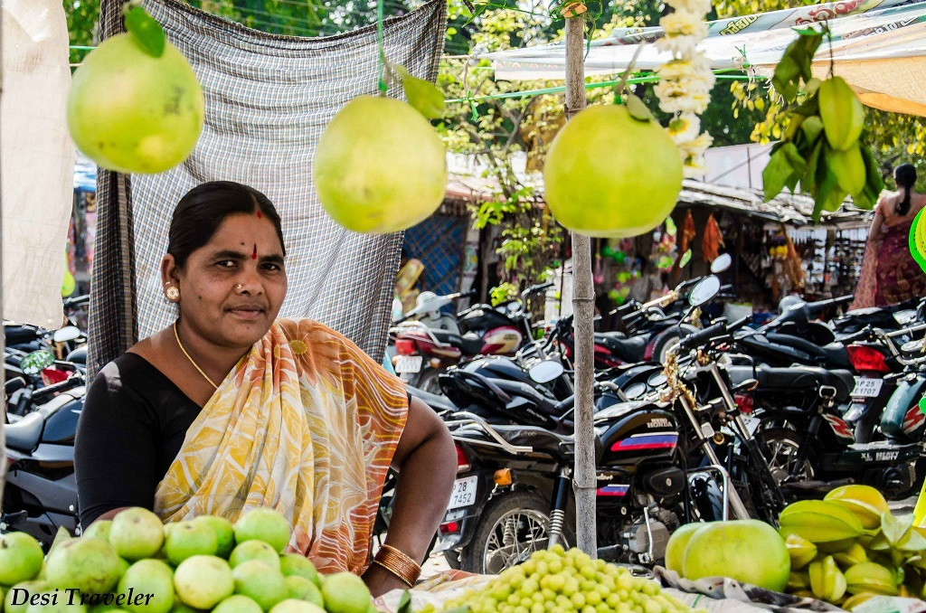Women selling Grapefruit, Indian gooseberry, guava, amla, carambola fruits of Telangana