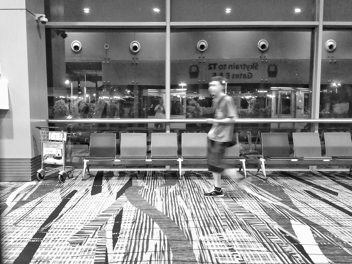 Man rushing from one terminal to another Changi Airport