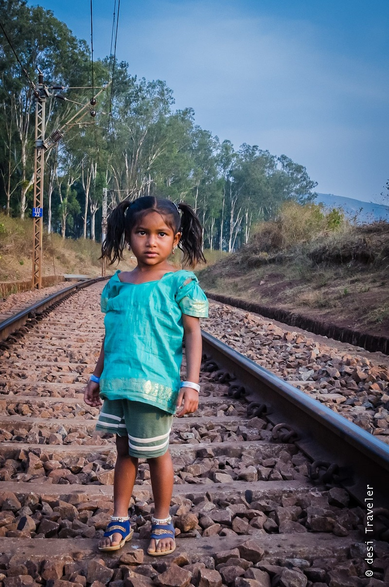 Girl crossing railway line