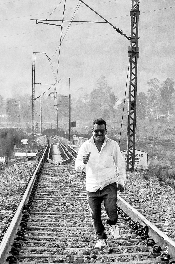Man running on railway tracks